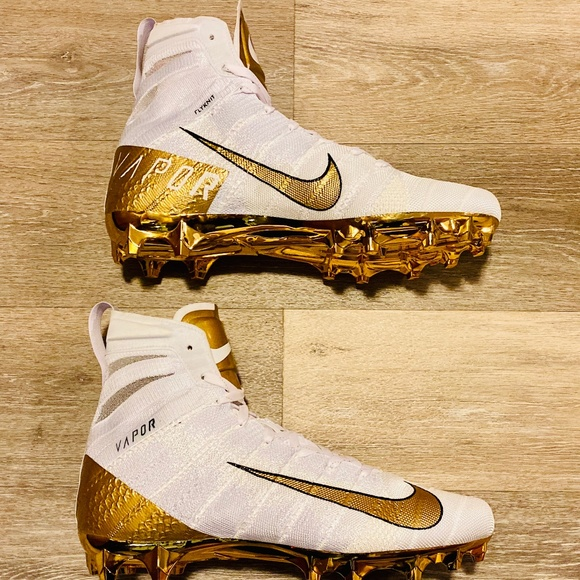 white and gold nike football cleats